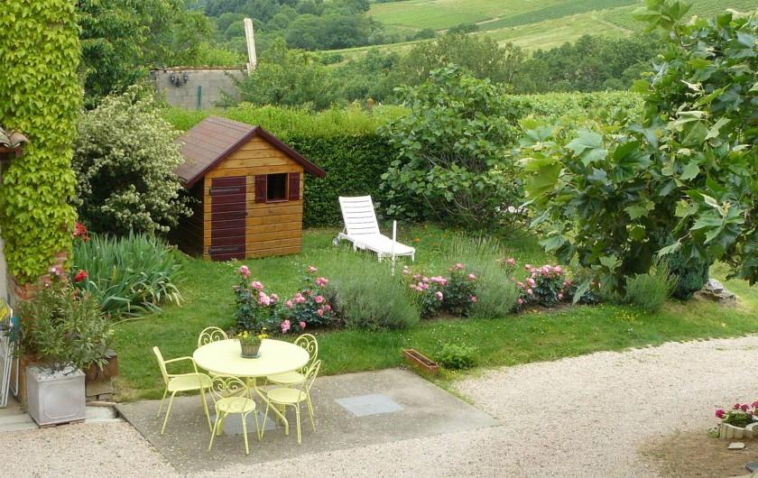 Location de vacances - Gîte à Le Glabat - Jardin et maison d'enfants