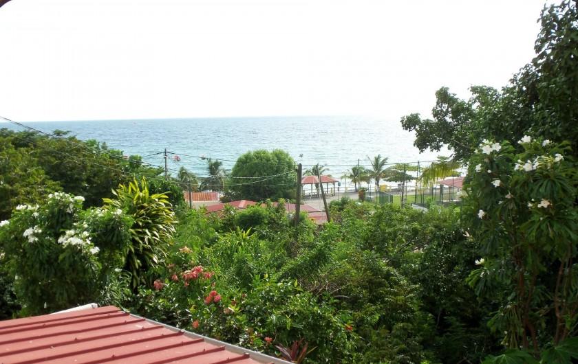 Location de vacances - Appartement à Les Anses-d'Arlet - Vue mer du balcon