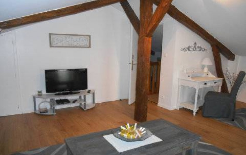 Location de vacances - Gîte à Saint-Vincent-sur-l'Isle - Le salon et son coin bureau