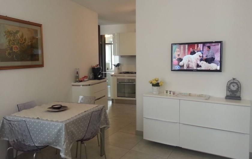 Location de vacances - Appartement à Bergame - angle repas 4 personnes