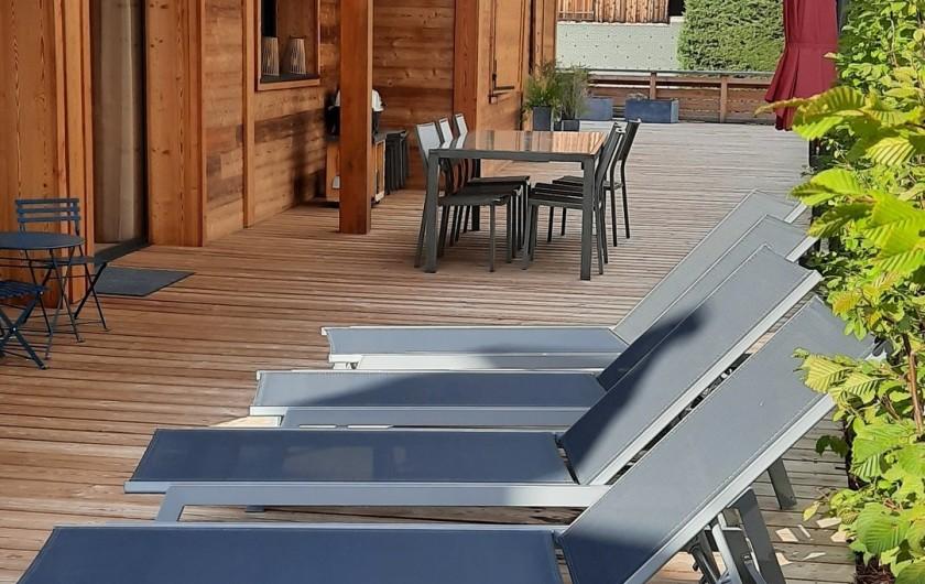 Location de vacances - Appartement à Les Gets - Terrasse espace détente