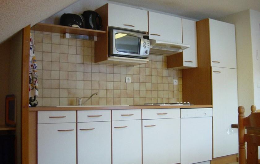 Location de vacances - Gîte à Valmeinier - Le séjour cuisine
