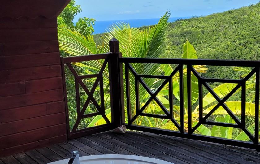 Location de vacances - Bungalow - Mobilhome à Deshaies - Piscine et le coin détente.