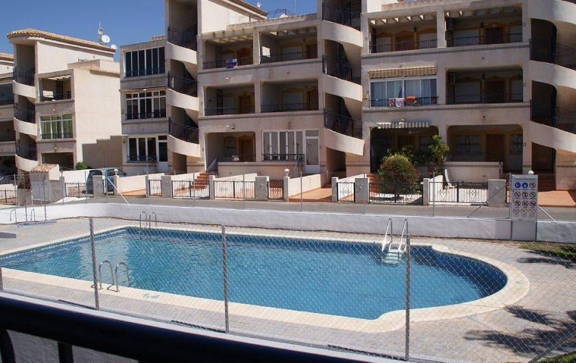 Location de vacances - Appartement à Punta Prima - Piscine au pied de l'immeuble