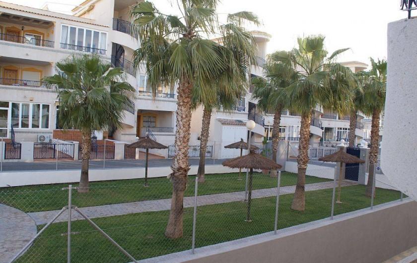 Location de vacances - Appartement à Punta Prima - Piscine coté détente