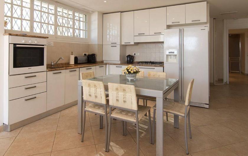 Location de vacances - Appartement à Cannes - Coin repas, cuisine américaine
