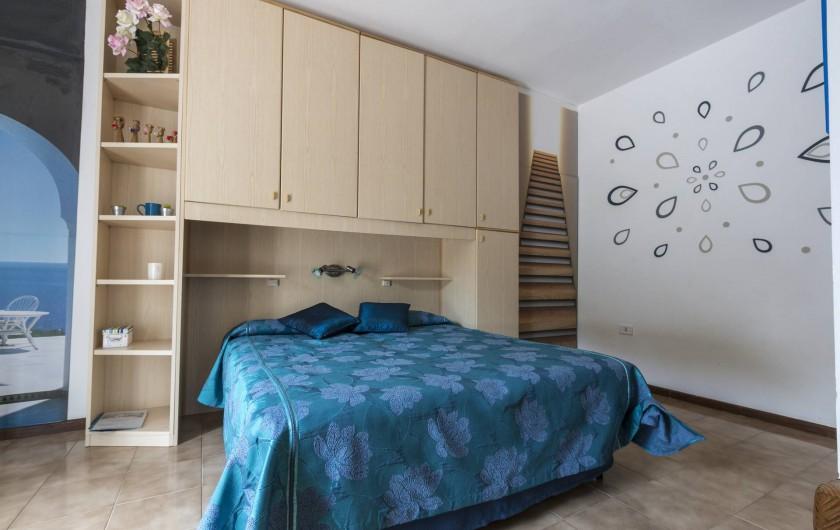 Location de vacances - Appartement à Capoliveri - chambre casetta