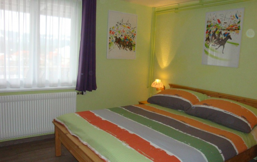 Location de vacances - Appartement à Les Breuleux - chambre à coucher
