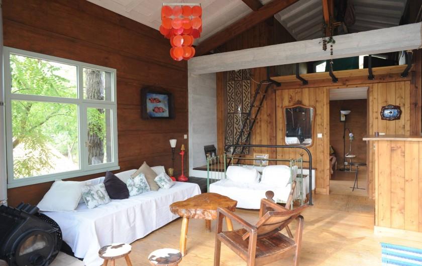 Location de vacances - Chalet à Le Cap Ferret - vue salle de séjour coté salon.