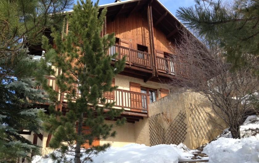 Location de vacances - Chalet à Briançon - chalet sous la neige