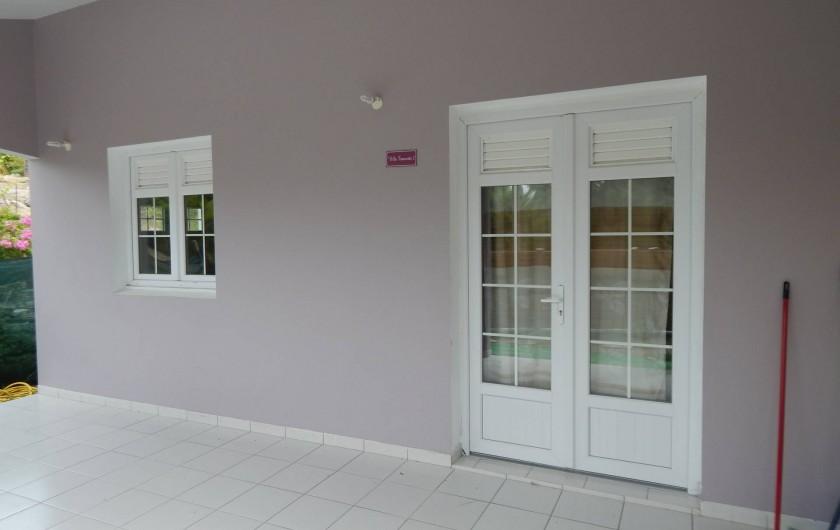 Location de vacances - Villa à Sainte-Anne - véranda appartement 2