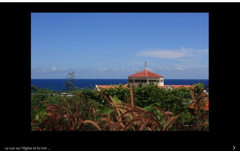 Location de vacances - Villa à Saint-Gilles les Bains - Le jardin et la vue mer