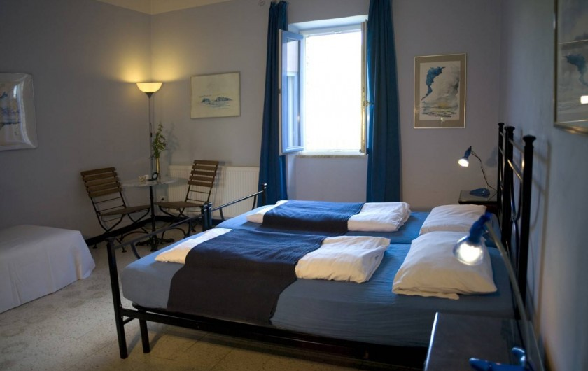 """Location de vacances - Appartement à Castel Rigone - Chambre lit """"Camera blu"""" dans appt. """"Il Peperino"""" La Rogaia"""
