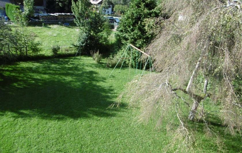 Location de vacances - Chalet à Alex - le jardin avec les balançoires