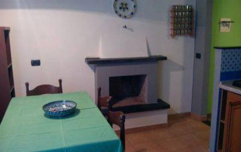 Location de vacances - Appartement à Levanto - salle a manger with camine