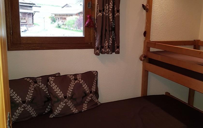 Location de vacances - Appartement à Le Grand-Bornand - Chambre lits superposés 1/2