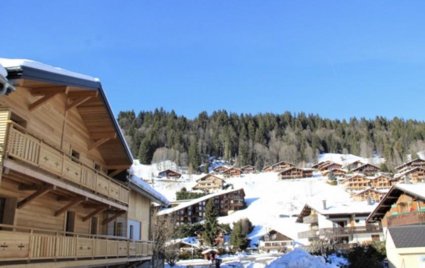 Location de vacances - Appartement à Les Gets - Vue / hiver