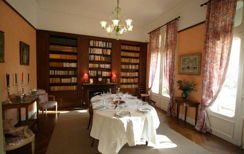 The dinning room and his bookcase