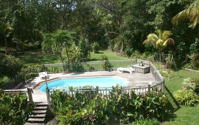 Location de vacances - Villa à Deshaies - La piscine vu de la térrasse