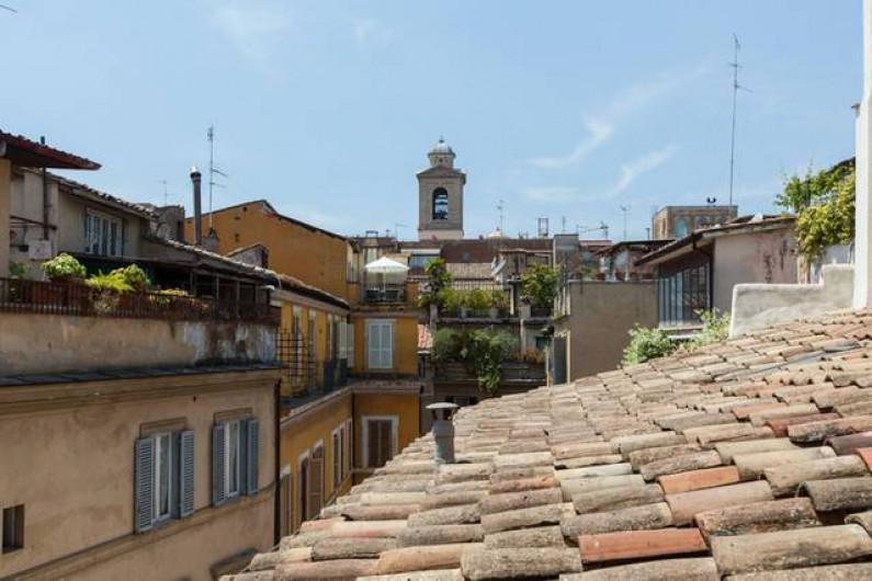 Location de vacances - Appartement à Rome - Vue sur les toits dans la chambre