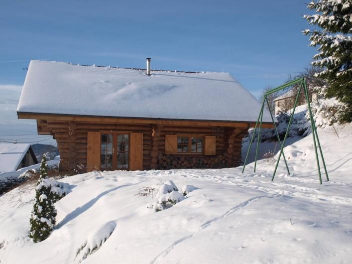 Location de vacances - Chalet à La Bresse - La terrasse sous la neige
