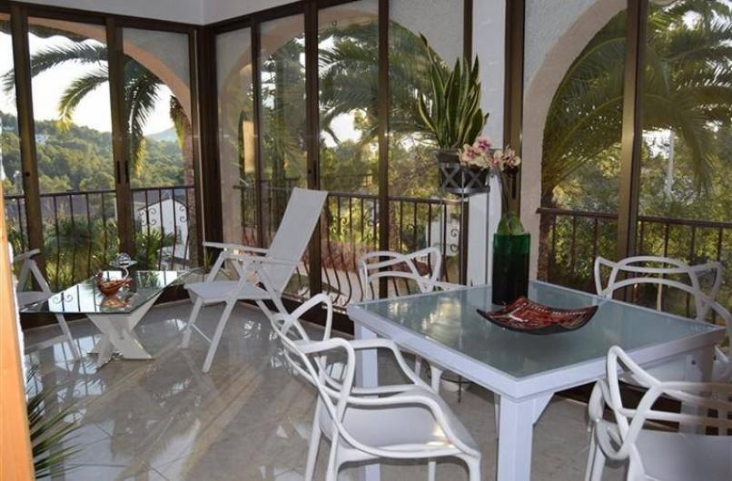Location de vacances - Villa à Gandia - terrasse cristal pour dining et relaxation