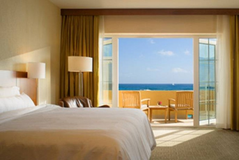Location de vacances - Appartement à Oyster Pond - chambre balcon & vue sur mer