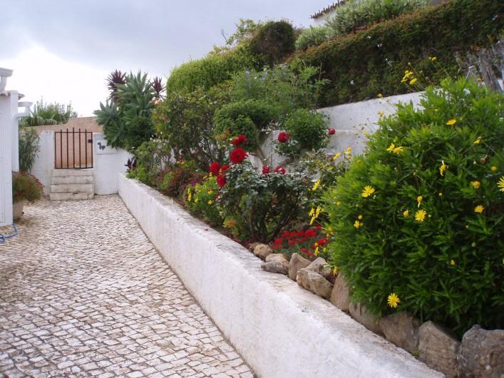 Location de vacances - Chalet à Luz - Jardin fleuri, petit portail