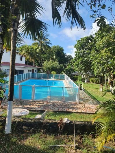 Location de vacances - Villa à Petit Bourg - piscine et Jardin