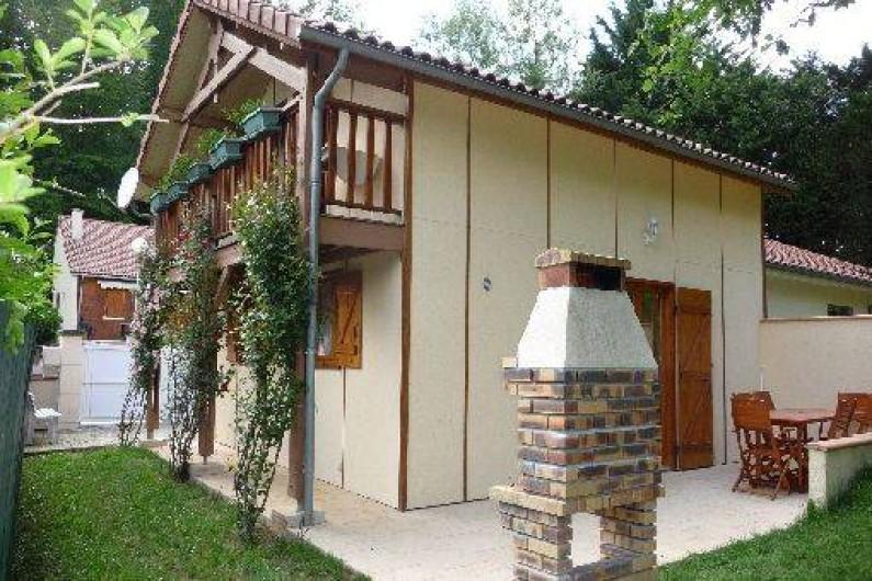 Location de vacances - Chalet à Saint-Gérons - Terrasse arrière donnant sur le bois
