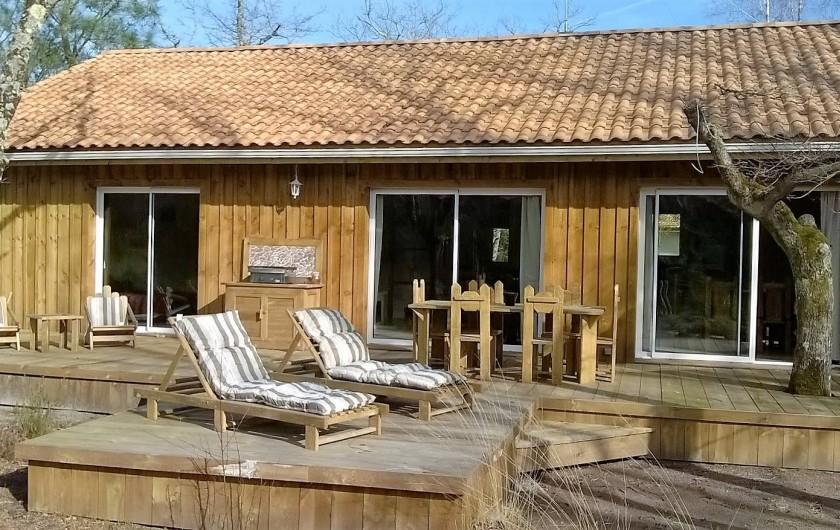 Location de vacances - Maison - Villa à Naujac-sur-Mer - terrasse derrière la maison avec vue sur la forêt