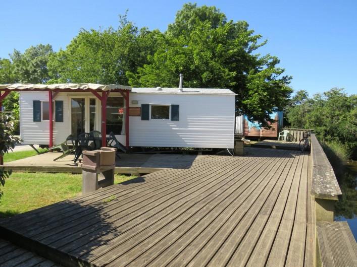 Location de vacances - Camping à Sallertaine - Mobilhome avec ponton de pêche