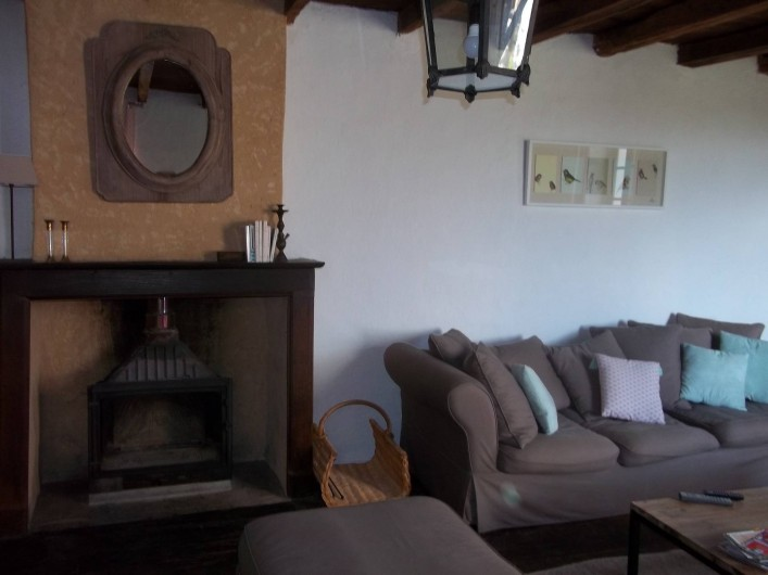 Location de vacances - Gîte à Biron - Un salon cosy ...