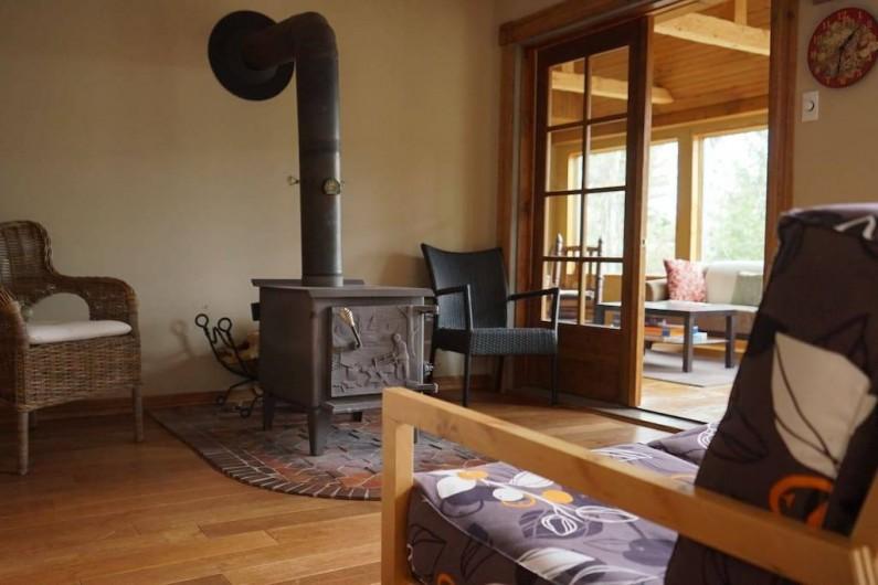 Location de vacances - Chalet à Les Éboulements - Poêle à bois
