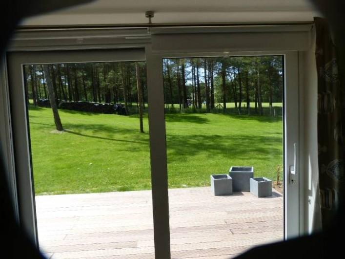 Location de vacances - Appartement à Hardelot-Plage - vue du salon sur le golf des dunes