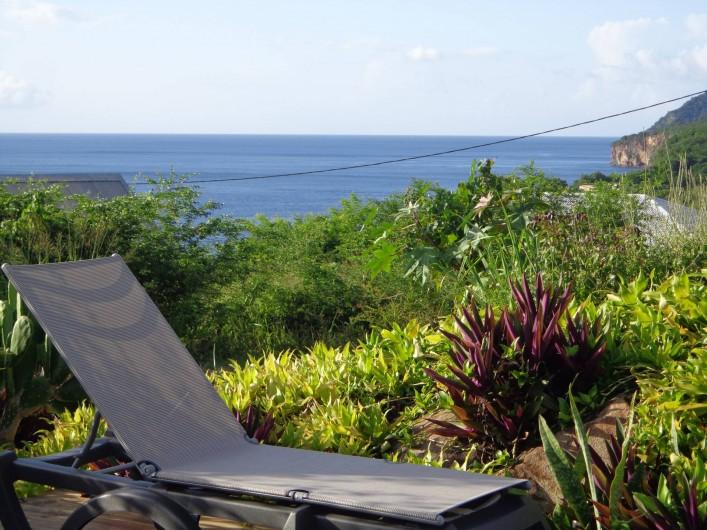Location de vacances - Bungalow - Mobilhome à Deshaies - vue depuis la piscine
