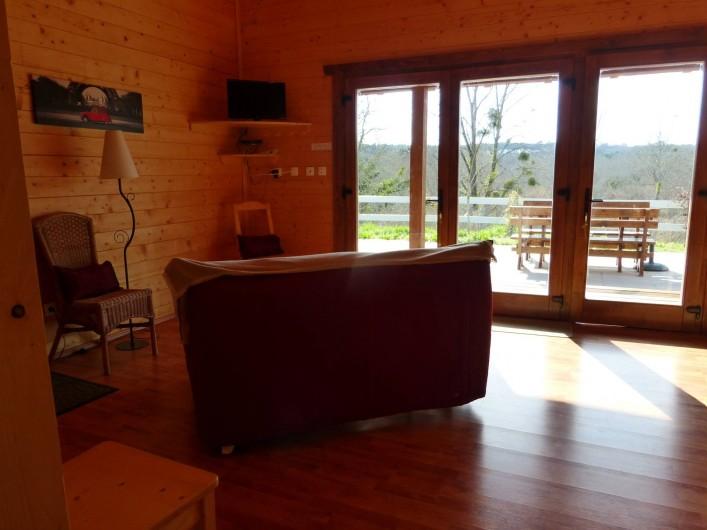 Location de vacances - Chalet à Pompiey - coin repos vue sur la forêt