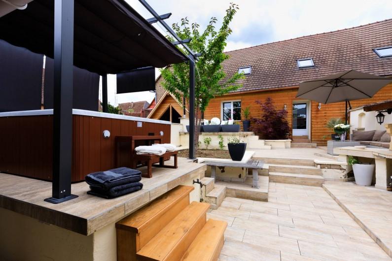 Location de vacances - Chambre d'hôtes à Bernardswiller - jardin et jacuzzi
