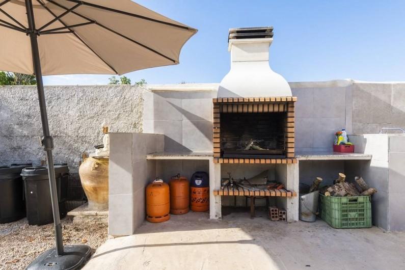 Location de vacances - Chalet à Les Cases d'Alcanar - Barbecue avec bois de chauffage disponible