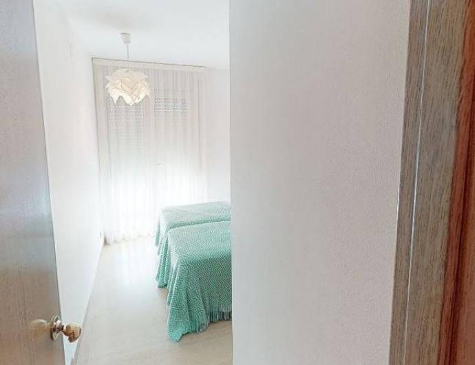 Location de vacances - Appartement à Sant Antoni de Calonge - chambre deux lits avec sortie directe au balcón - terrasse