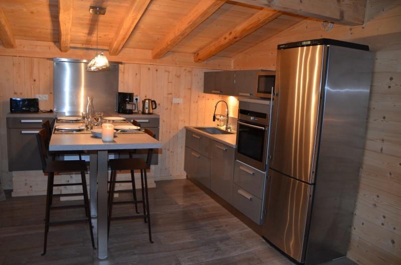 Location de vacances - Studio à L'Alpe d'Huez - salle à manger et cuisine