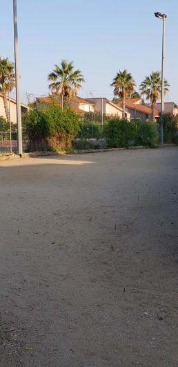 Location de vacances - Villa à Saint-Cyprien Plage - Terrain de boules de la résidence