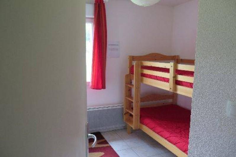 Location de vacances - Appartement à Gérardmer - Chambre avec lits superposés