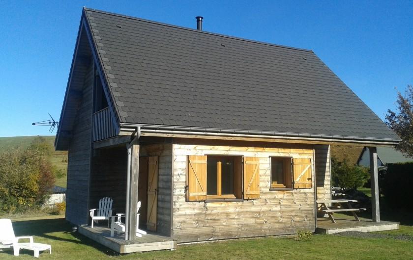 Location de vacances - Chalet à Chastreix - Le chalet (vue terrasse 2 et balcon)
