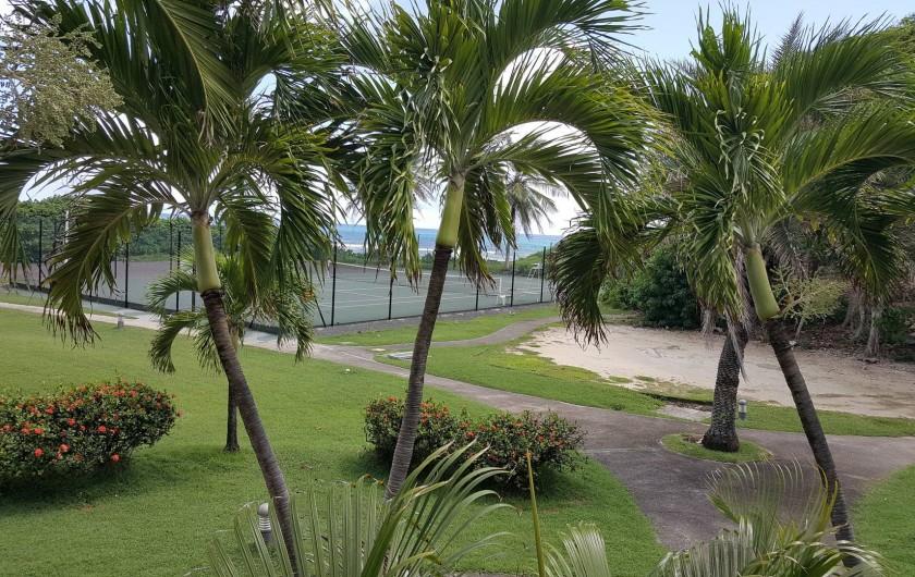 Location de vacances - Appartement à Saint-François - vue mer sur la gauche