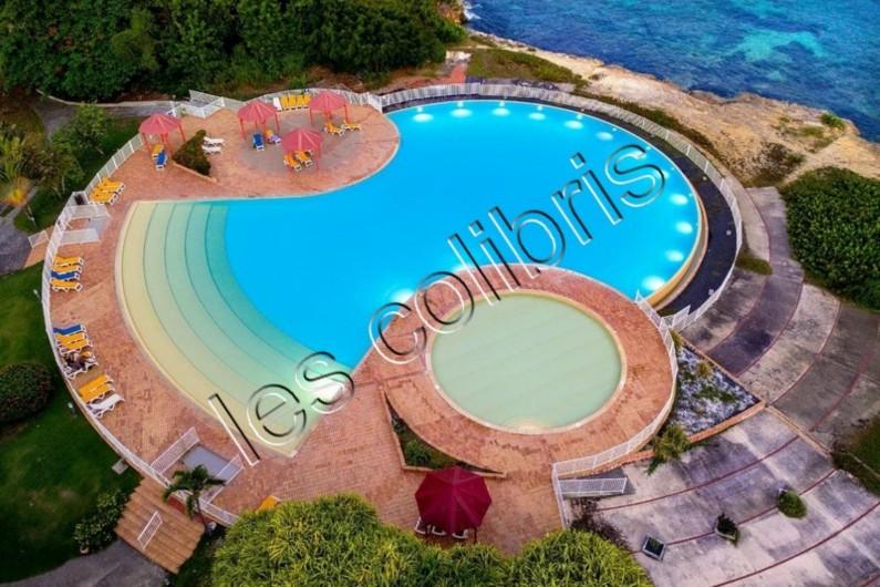 Location de vacances - Appartement à Saint-François - piscine vue d'avion