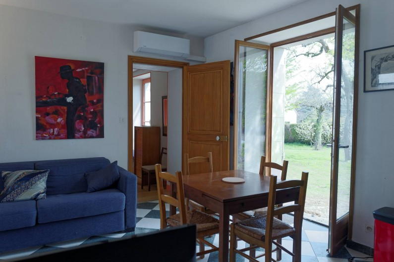 Location de vacances - Appartement à Saint-Dyé-sur-Loire - Salon avec accès jardin