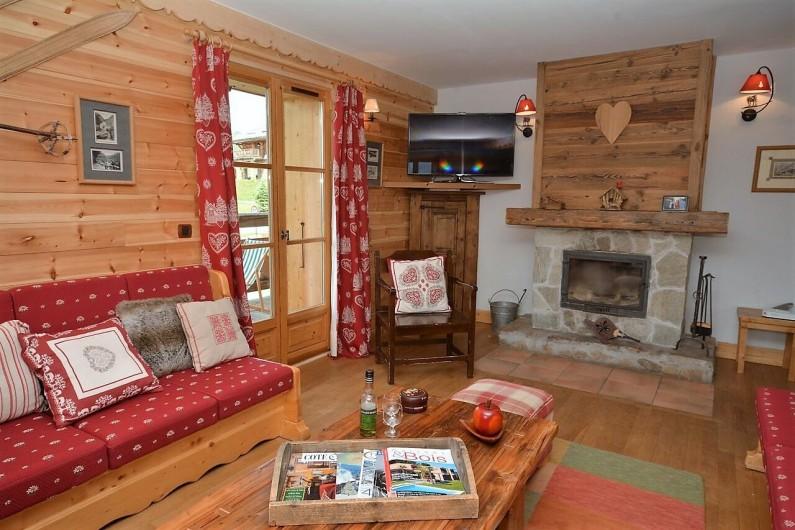 Location de vacances - Chalet à L'Alpe d'Huez - Salon avec sa cheminée