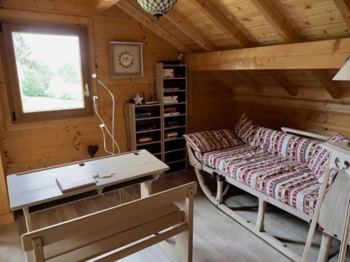 Location de vacances - Chalet à La Pesse - mezzanine avec canapé une place