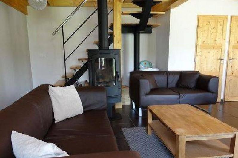 Location de vacances - Maison - Villa à Astugue - Salon avec le poële